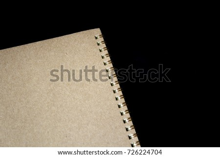 notebook on wood board