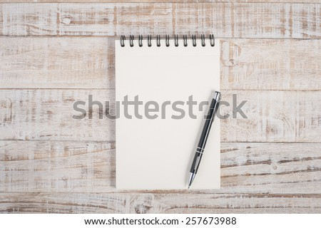 Notebook on wood table for background - stock photo