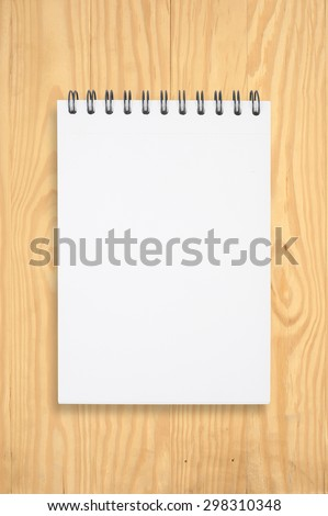 Notebook on wood table for text and background