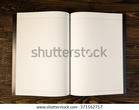 notebook on wooden table