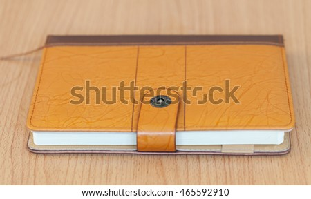 notebook over a wooden background