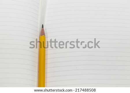 Notebook Page with Pencil - stock photo