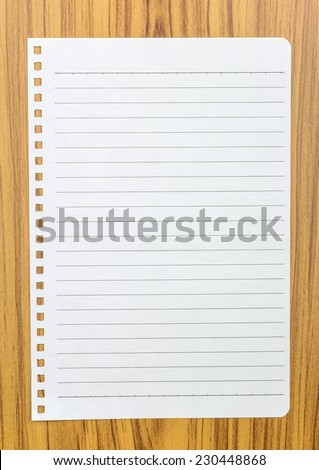 Notebook paper on wood background