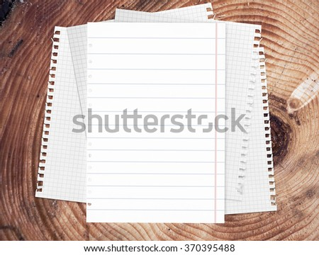 Notebook paper  on wood table for text and background