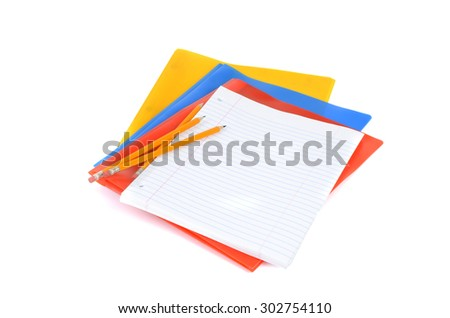 notebook paper pencils and folders isolated on white background - stock photo