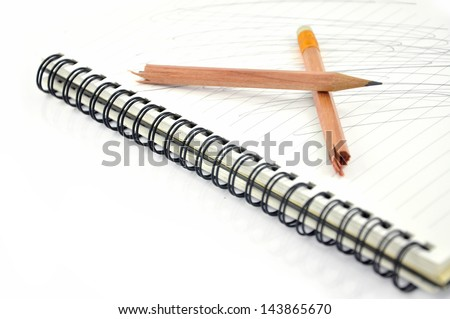 Notebook paper with broken pencil - stock photo