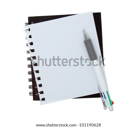 Notebook paper with pen on white background