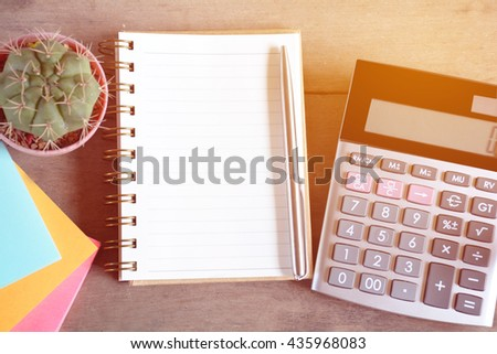 Notebook, pen and calculator.