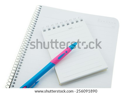 Notebook pen and postit note - stock photo
