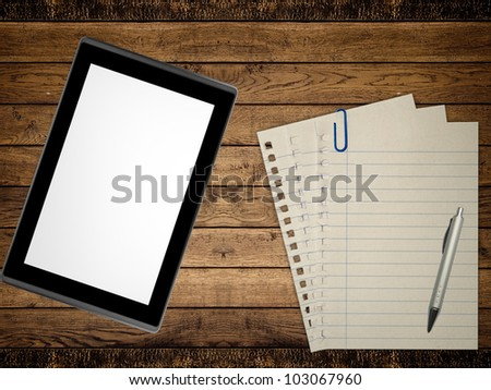 Notebook, pen and tablet pc on wood table background. Business concept - stock photo