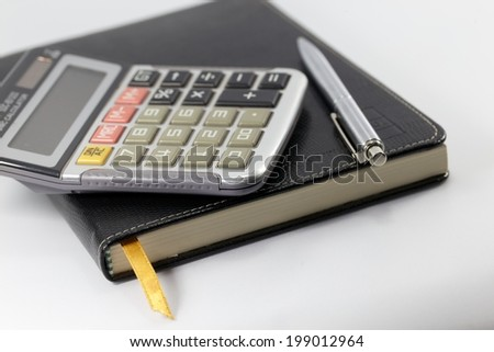 Notebook , pen, calculator for finance and business on white