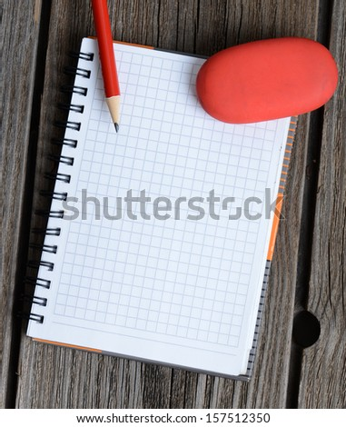 notebook, pencil and eraser - stock photo