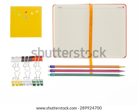 Notebook, pencil and paper clips with copy space - stock photo