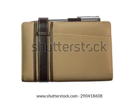 Notebook's cover with pen. - stock photo