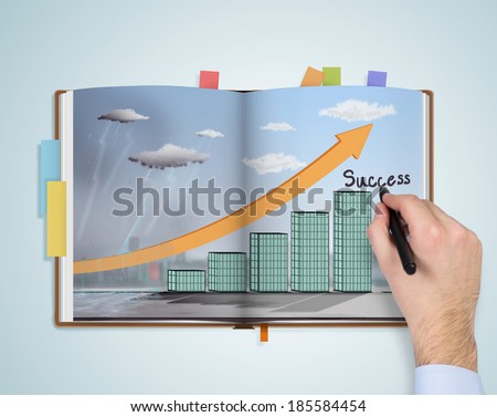 Notebook, sketch of the way to success - stock photo
