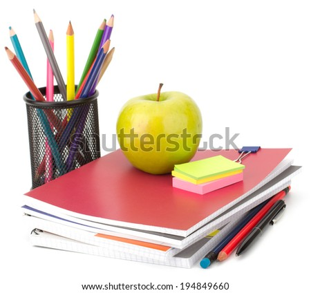 Notebook stack and pencils. Schoolchild and student studies accessories. Studies concept.