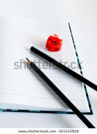 Notebook, two pencils and sharpener - stock photo