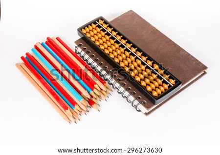 Notebook with abacus and wooden pencil isolated on white background