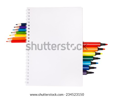 notebook with colored pencils and markers on white background with space for text - stock photo