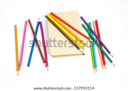 notebook with colour pencils on white background - stock photo