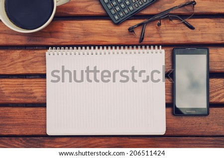Notebook with copyspace on table with coffee  - stock photo