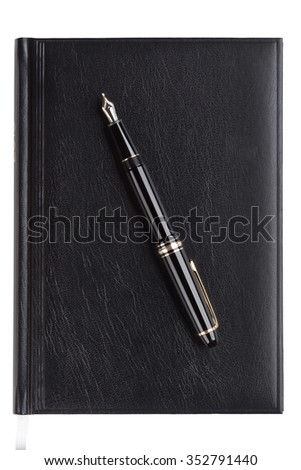 Notebook with fountain pen over white background - stock photo