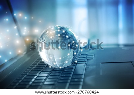 Notebook with Globe - stock photo