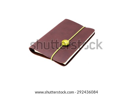 Notebook with green rope band in isolated over white background - stock photo