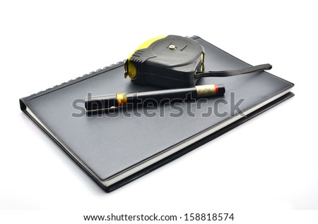 Notebook with  meter on a white background. - stock photo