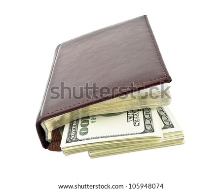 notebook with money inside isolated on white background