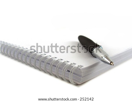 notebook with pen - stock photo