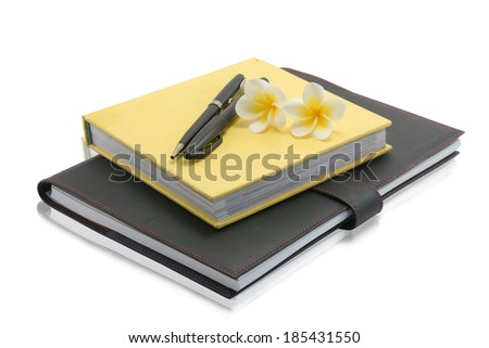 notebook with pen and flower on a white background  - stock photo