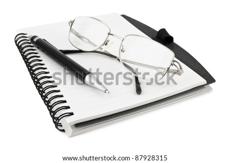 Notebook with pen and glasses on white - stock photo