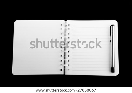 Notebook with pen - Spiral bound notebook with lined paper and a pen - stock photo