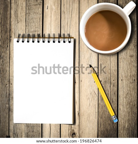 Notebook with pencil, coffee on wooden background - stock photo
