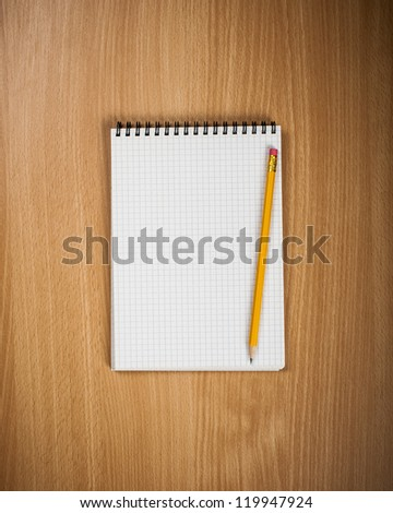 Notebook with pencil on wood background - Back to school concept - stock photo