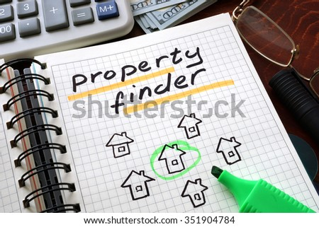 Notebook with property finder  sign on a table. Business concept. - stock photo