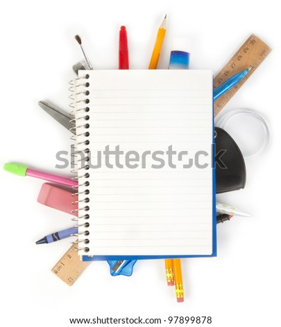 Notebook with stationary objects in the background - stock photo