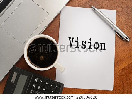 Notebook with text vision on table with coffee, calculator and notebook  - stock photo