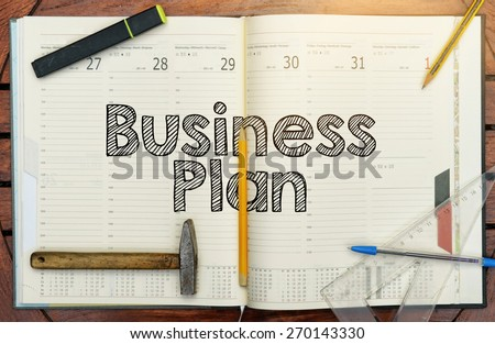 notebook with the note in the center about the Business Plan - stock photo