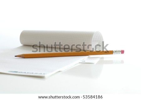 Notebook with the pencil on the white table - stock photo