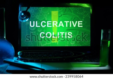 Notebook with words  Ulcerative Colitis, test tubes and stethoscope - stock photo