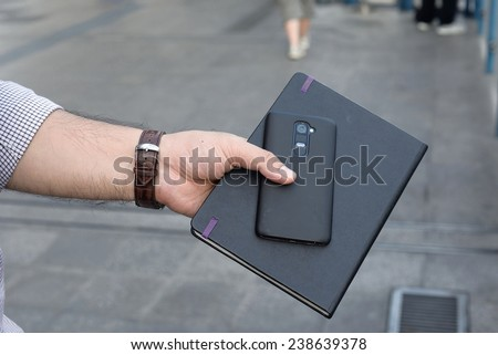 Notebooks and Mobile phone of business man.
