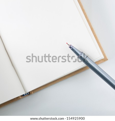 Notebooks and pen to take notes in class - stock photo