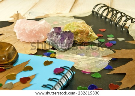 notebooks, autumn leaves and stones closeup - stock photo