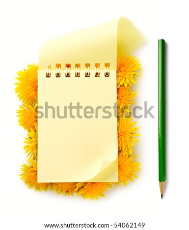 Notepad and flowers isolated on the white background