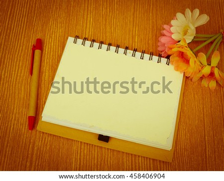 notepad and pen on wooden background