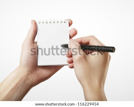 notepad and pencil in hand - stock photo