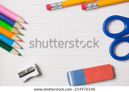 Notepad and school work supplies on it - stock photo