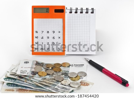 Notepad, calculator and Russian money - stock photo